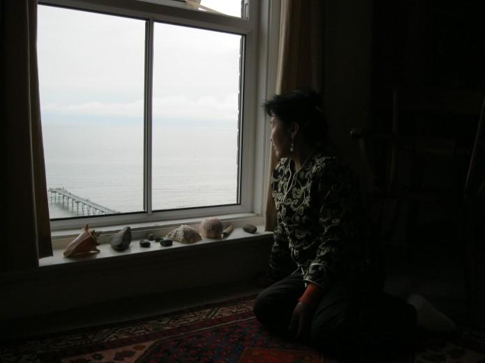 My mum Bayarsanaa looking at the North Sea, Saltburn-by-the-Sea, North Yorkshire, England, UK